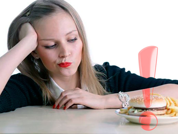 Первый шаг лечения изжоги и тяжести в желудке - отказ от фастфуда и газированных напитков